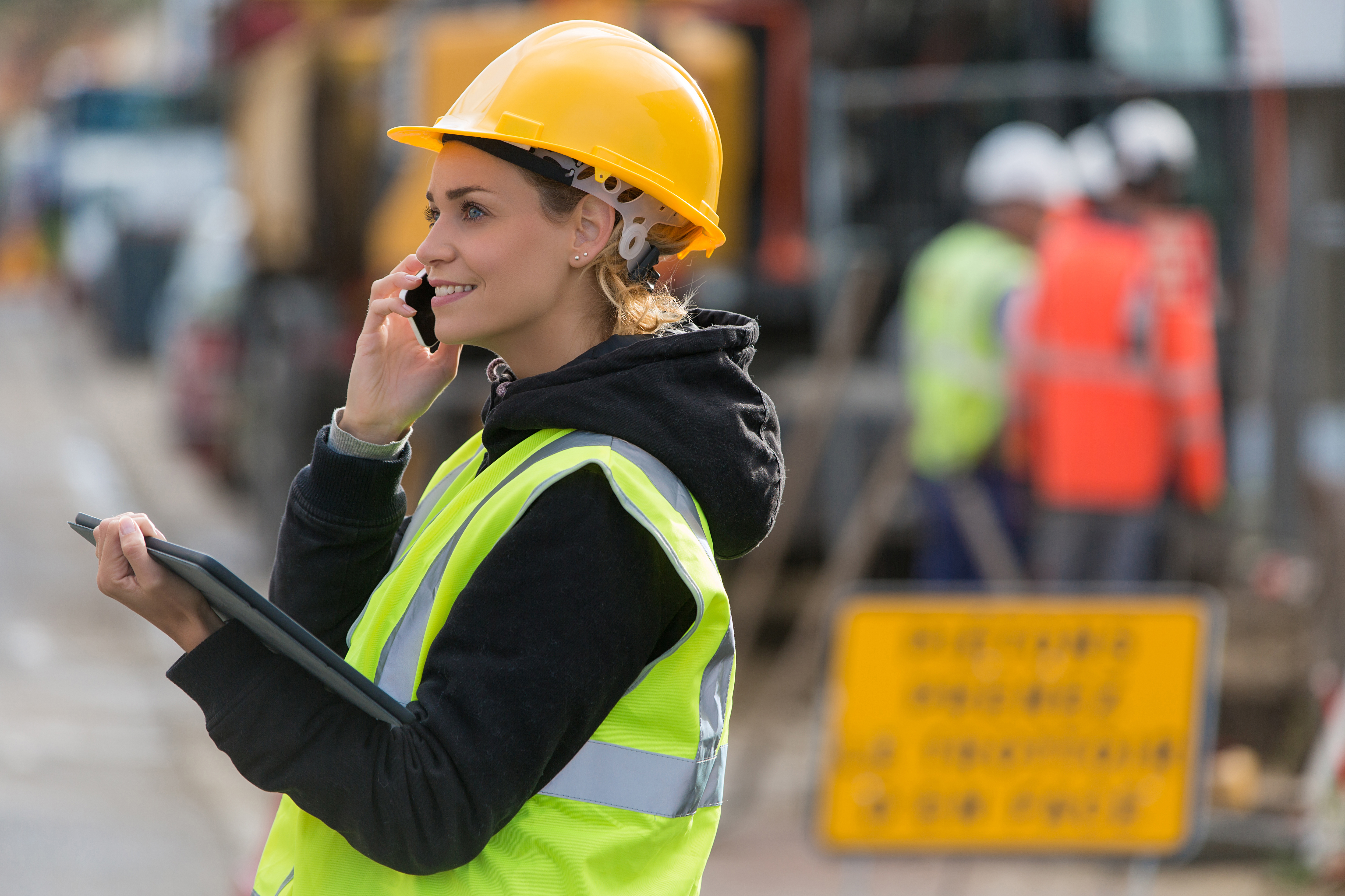 shutterstock_771085426 female construction worker on the phone
